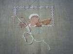 La pochette pour bébé avant reprise de la broderie