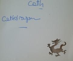 La carte de Cath avec le dragon perforé