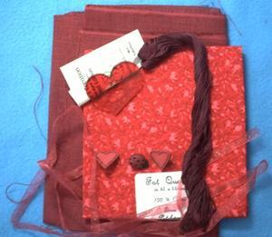 Le paquet reçu pour l'échange en rose en rouge, le contenu