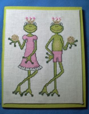 Un cahier avec des grenouilles brodées