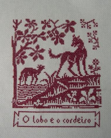 Le loup et l'agneau, broderie et cartouche