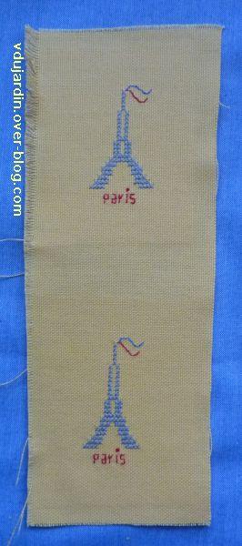 Deux tours Eiffel brodées sur toile jaune