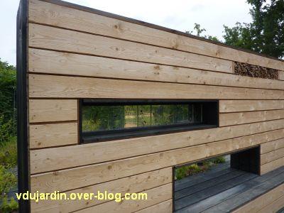 Chaumont-sur-Loire, festival 2011, le jardin 22, 3, le revers du mur de bois avec des graines