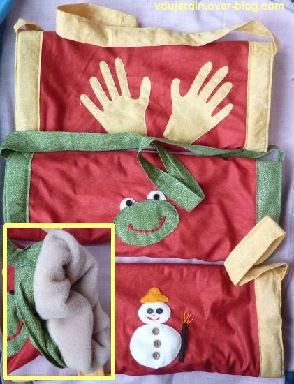 Trois manchons en appliqué avec des mains, une grenouille et un bonhomme de neige